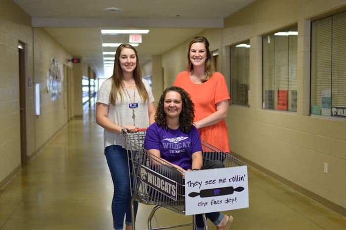 teachers with shopping cart