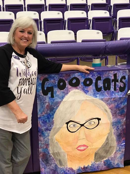 Alva Reibe with her GOOOO CATS sign