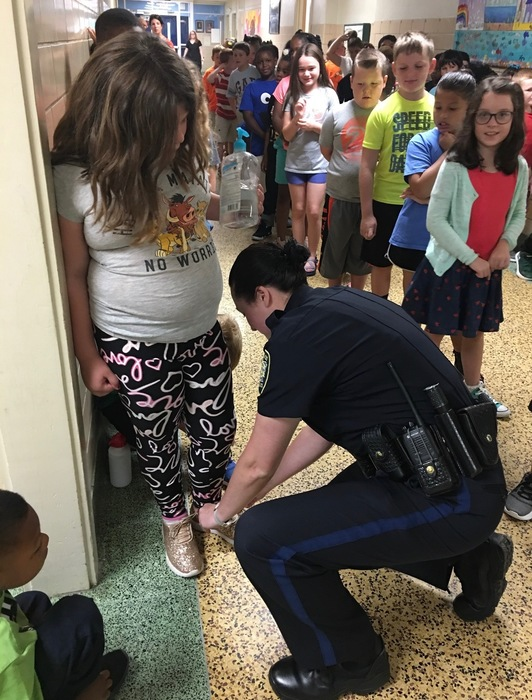 Officer Benton helping out a student!