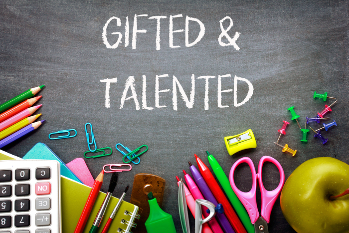 Gifted & Talented on a chalkboard with school supplies around it