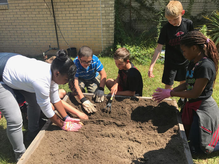Students working in the WMS garden.