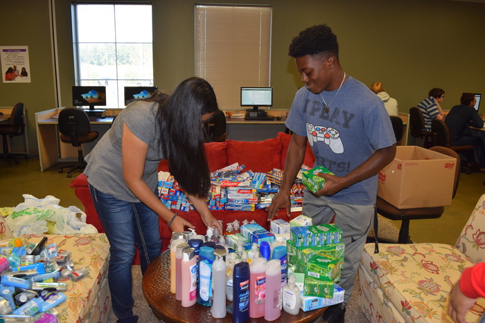 Junior Paula Leija and senior Keonta Barnes counting supplies.