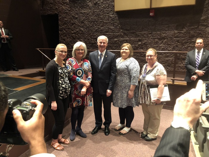 EHS Computer Science and technology teachers with Principal Reibe and Governor Asa Hutchinson